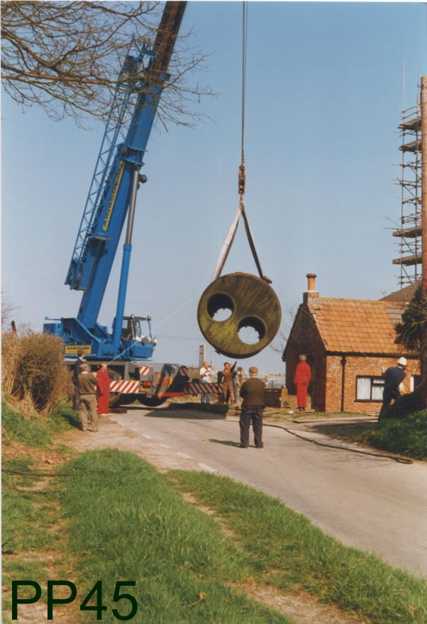 A crane moving the boiler
